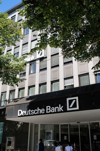 Mannheim, Germany - August 23, 2017: Deutsche Bank sign outside a local branch. It is a German global banking and financial services company with its headquarters in Frankfurt Business Deutsche Bank Bank Banking Building Exterior Finance Financial Money Outdoors Saving Money Savings Sign