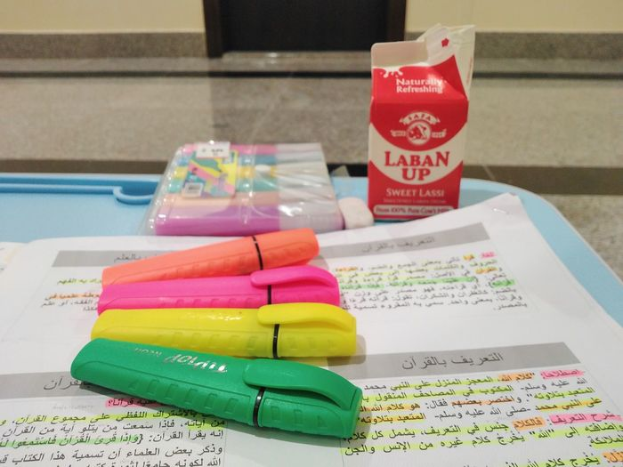 High angle view of multi colored book on table