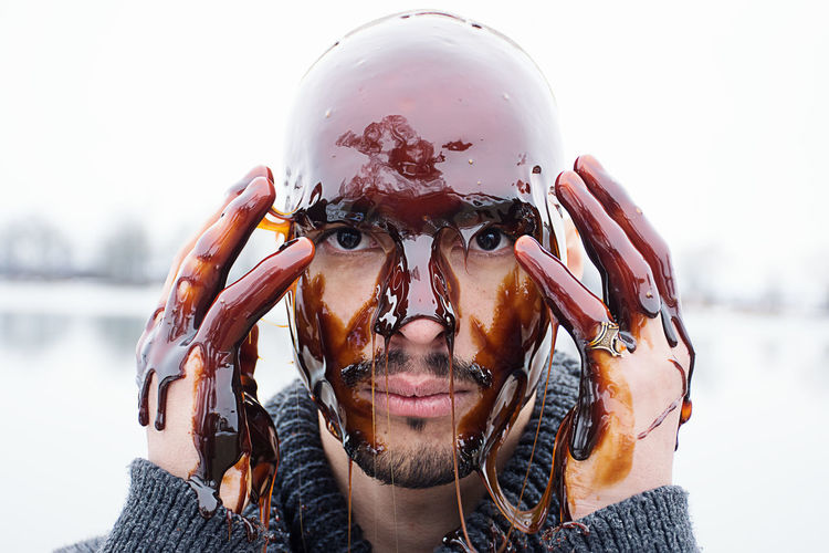 man with syrup on head Fluids Adult Close-up Cold Temperature Focus On Foreground Front View Headshot Looking At Camera One Man Only One Person Outdoors Over Head Portrait Real People Young Adult