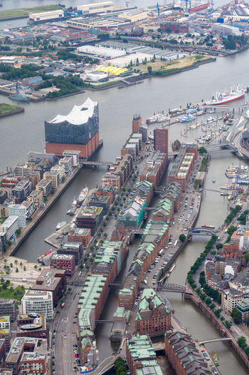 Aerial view of river amidst buildings in city
