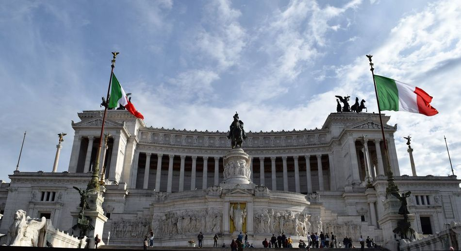 vittoriano Altare Della Patria Architecture Art And Craft Building Exterior Built Structure Cloud Cloud - Sky Famous Place Flag Large Group Of People Low Angle View National Flag Patriotism Person Sky Tourism Travel Travel Destinations