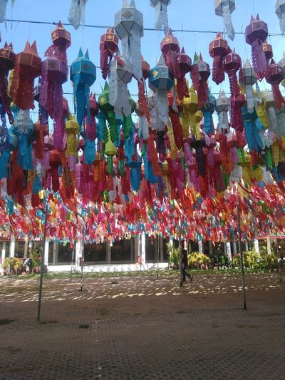 Hanging Multi Colored Decoration Tree Cultures Celebration Travel Destinations Creativity Abundance In A Row Sky Day Outdoors Colorful Tranquility Decorated Memories Event No People Large Group Of Objects โคมไฟ งานวัดหริภุญชัยจังหวัดลำพูน