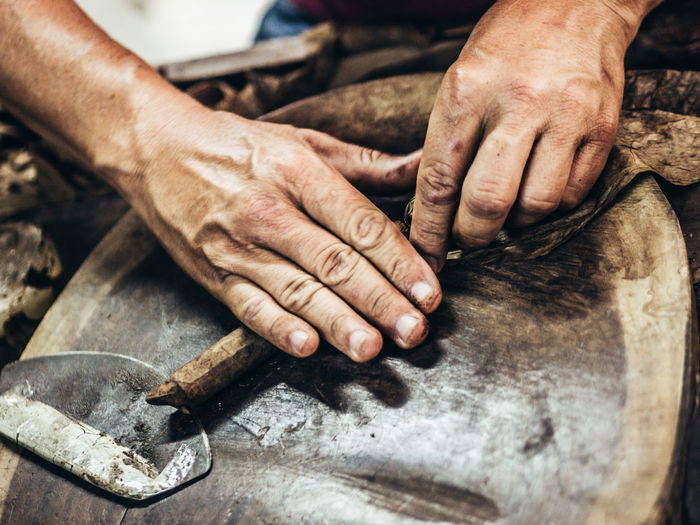 Art And Craft Chisel Craft Expertise Finger Focus On Foreground Hand Holding Human Body Part Human Hand Indoors  Men Occupation One Person Real People Skill  Wood - Material Work Tool Working Workshop