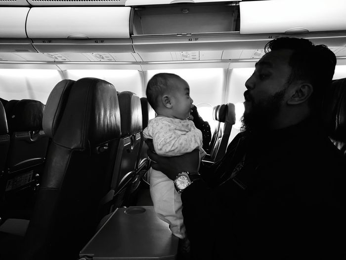 father and baby daughter in an aeroplane. Indoors  Adult People Young Adult Day Adults Only Family Trip Travel Photography Traveling Adult Airplane Seat Vacations Commercial Airplane Vehicle Seat Child Passenger Mode Of Transport Journey Travel Sitting Airplane Transportation Vehicle Interior Baby And Daddy Baby Love