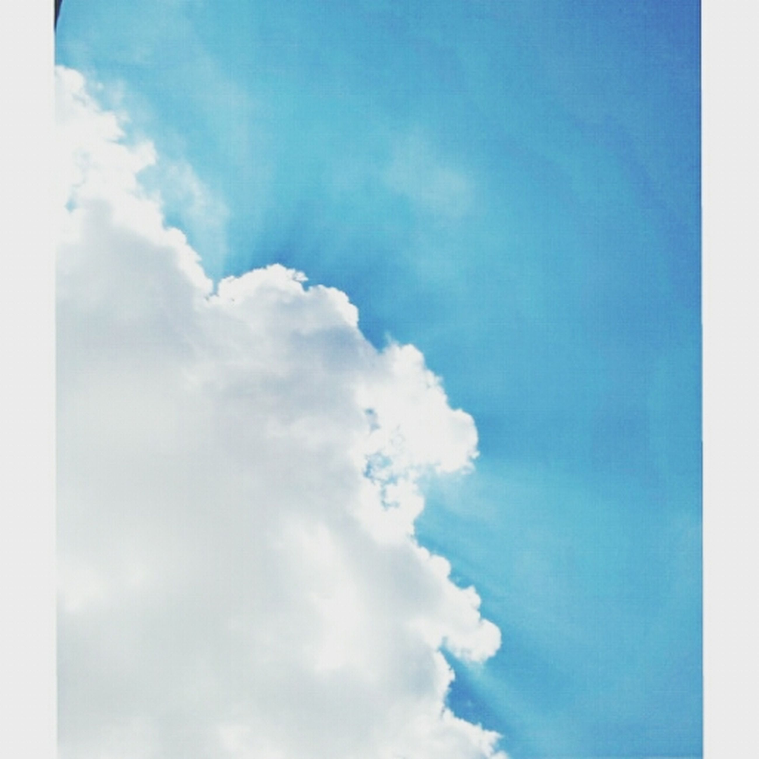sky, low angle view, blue, cloud - sky, cloud, sky only, beauty in nature, cloudy, nature, scenics, tranquility, cloudscape, backgrounds, tranquil scene, day, no people, outdoors, white color, idyllic, white