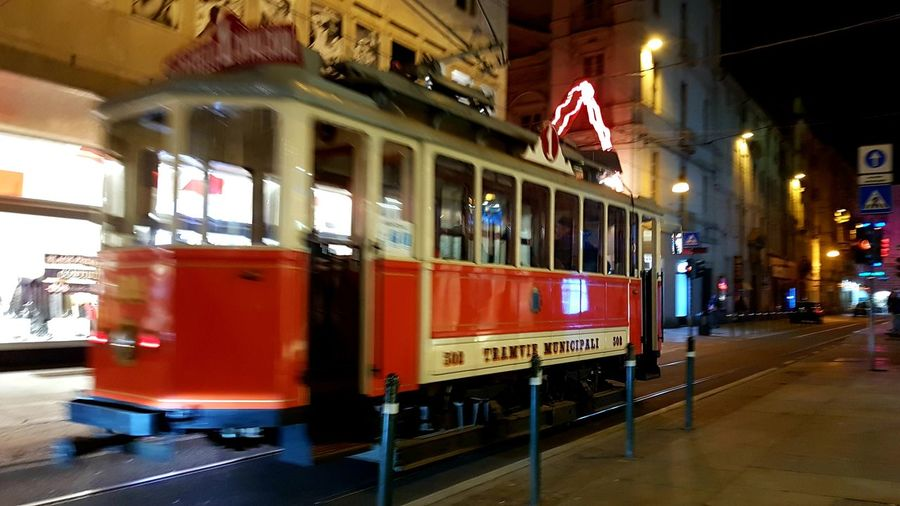 Red Tram Street Photography Picture In Motion City Motion Capture Walking Around The City  Turin Italy Street By Night Illuminated City Architecture Public Transportation Moving Passenger Train Tram Tramway Land Vehicle It's About The Journey The Art Of Street Photography