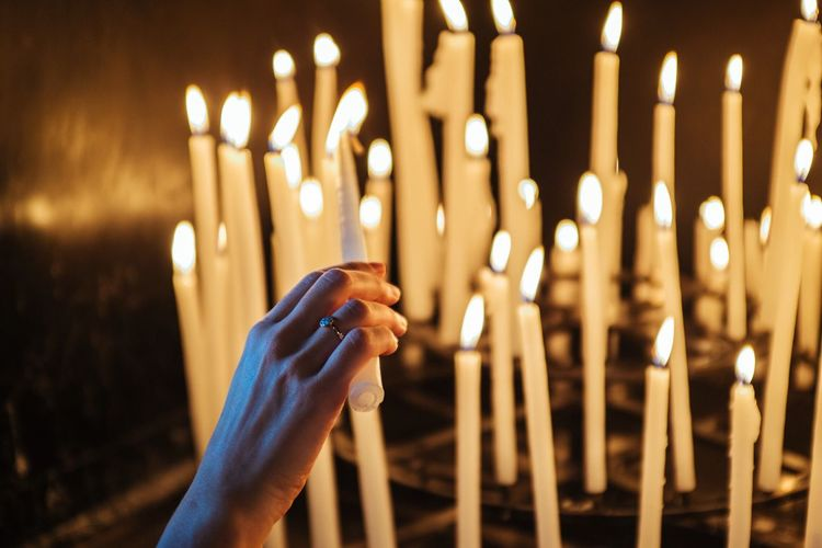Church Human Hand Glowing Burning Candle Flame Heat - Temperature Illuminated Close-up FUJIFILM X100S