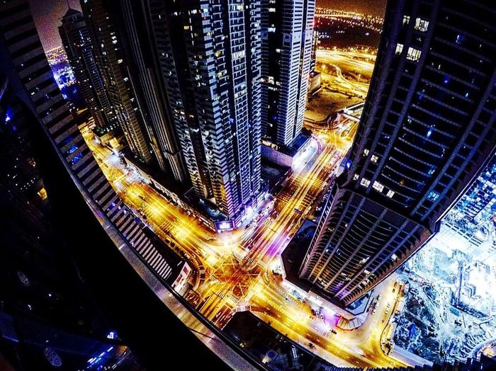City Skyscraper Cityscape Architecture Building Exterior Illuminated Modern Financial District  Night High Angle View Built Structure City Life Aerial View Downtown District Travel Destinations Business Finance And Industry Futuristic No People Outdoors