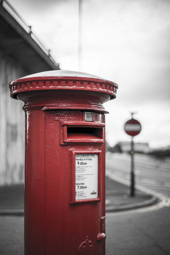 50mm City Close-up Cloudy Communication Cultures Day England Lowsaturation Mail Mailbox Mailboxes No People Outdoors Pay Phone Public Mailbox Red Telephone Booth Vertical