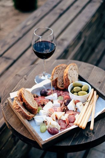 Still life shot of snacks and red wine Glutenfree Food And Drink Gastronomy Wine Red Wine Snack Time! Food And Drink Food Drink Glass Alcohol Wine Wineglass Freshness Healthy Eating Refreshment Bread Table Dairy Product No People Drinking Glass Meat Household Equipment