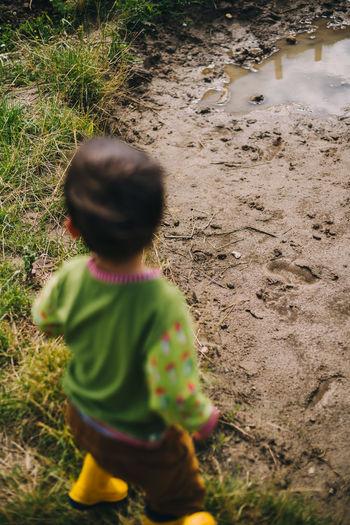 Rear view of boy on field