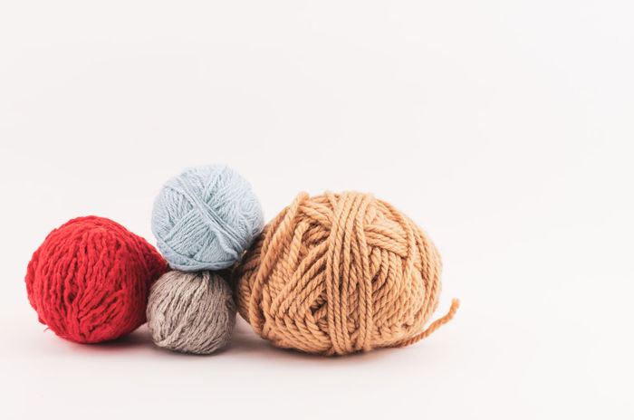 woolen balls Wool Ball Of Wool White Background Material Studio Shot Knitting Textile Art And Craft Craft Indoors  Cut Out Creativity Knitting Needle Multi Colored Still Life Close-up Copy Space Thread Softness Sewing Needle Yarn Balls