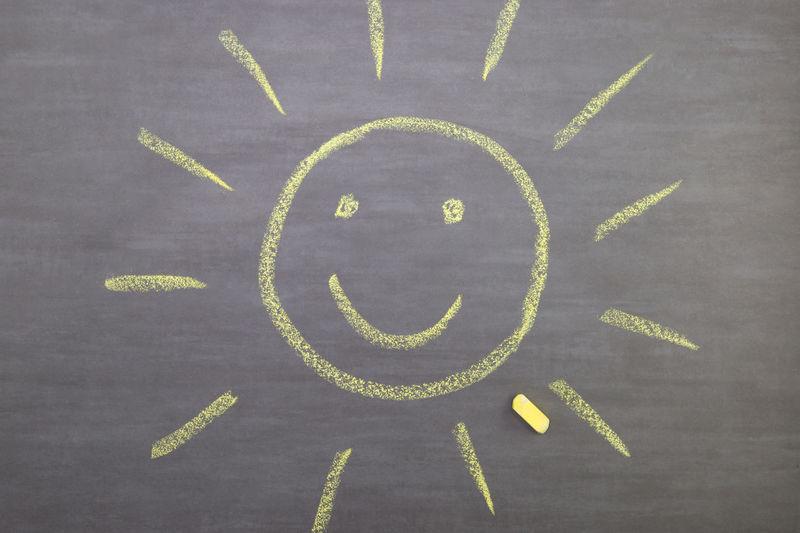 Directly Above Shot Of Sun Drawn On Blackboard
