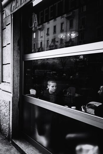 11 // Milano // Jan'17 Reflection Window Store One Person Retail  Only Women One Woman Only Choice Outdoors Adult People Day Monochrome Blackandwhite Italy Milano IPhoneography Eleven Cafe