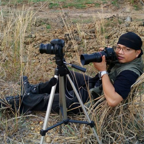 Photography Themes Camera - Photographic Equipment One Person Tripod Lens - Eye One Man Only Men Outdoors Day Photo Of The Day Indonesiabeauty Hunters Huntingseason Nikkonphotography Nikkon Beauty In Nature