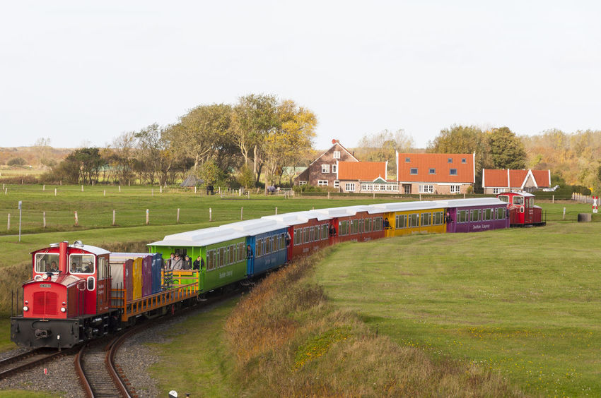 Colorful Langeoog Mode Of Transport Passenger Train Public Transport Public Transportation Rail Transportation Railroad Track Train Train - Vehicle Transportation Travel Shuttle Train Diesel Locomotive Color Palette