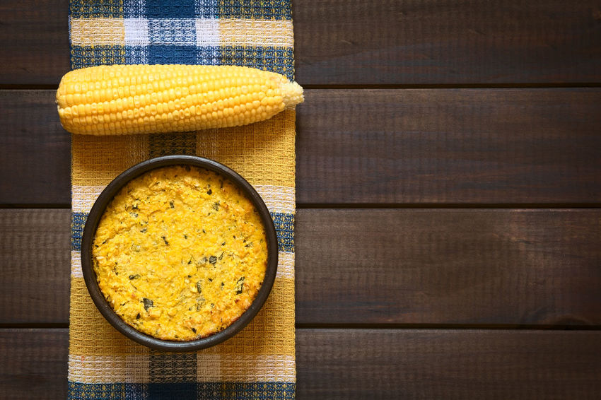 Traditional Chilean corn pie called Pastel de Choclo served in bowl, below the corn-basil mix is ground meat, olive, boiled egg, raisins and pieces of chicken Chile Chilean  Choclo Copy Space Homemade Homemade Food Meal Pastel De Choclo South American Food Baked Chilean Food Corn Corn Pie Food Food And Drink Fresh Overhead View Pastel Pie Salty Savory Savory Food Savory Pie Vegetable Yellow