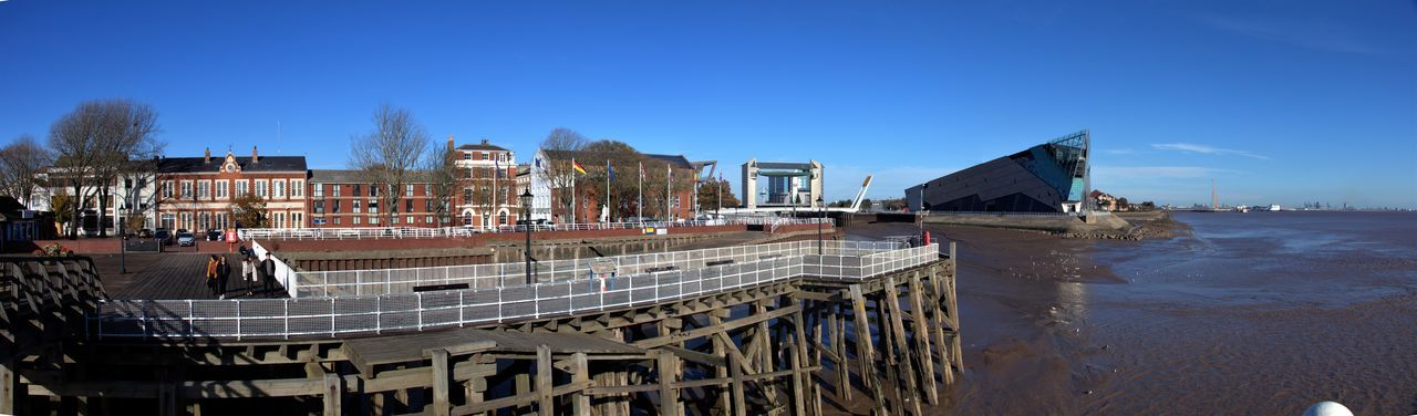 Hull Corporation Pier, River Hull tidal surge barrier and The Deep (aquarium). United Kingdom Pier Fencing Architecture Sky Built Structure Water Building Exterior Nature Day Blue Panoramic Building Clear Sky Outdoors Travel City Sea No People Sunlight Beach Travel Destinations Bridge Tourism River Clear Sky EyeEmNewHere