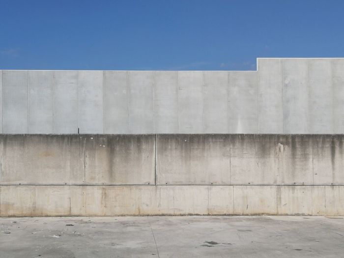 Concrete wall against blue sky
