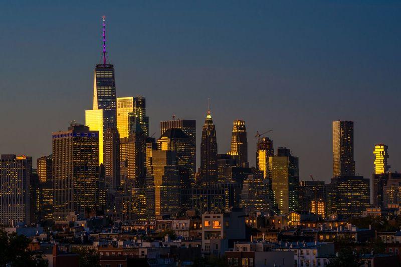 Illuminated Skyscrapers In City