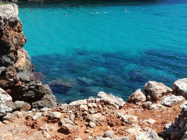 Beaches Of Mallorca Calas Hermosas De Mallorca EyeEm Selects Water Sea Beach Blue Sand Sunlight Rock - Object High Angle View Idyllic Turquoise Colored Turquoise Rock Bay Rocky Coastline Lagoon Seascape Stone Rock Formation