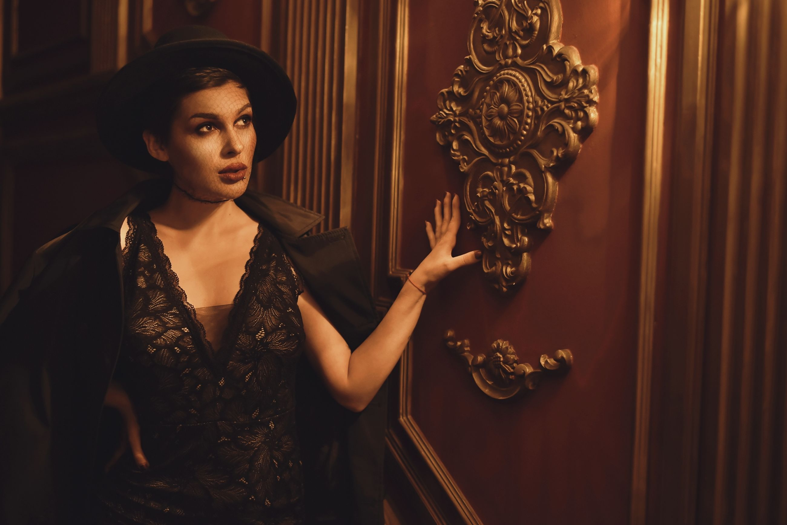 one person, adult, young adult, women, portrait, indoors, clothing, fashion, arts culture and entertainment, elegance, standing, looking at camera, female, looking, gold, dress, curtain, waist up, glamour, front view, wealth, brown hair, serious