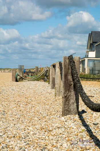 The rope divide Built Structure Sky Building Exterior Day Travel Outdoors Sunlight Cloud - Sky Backgrounds Low Angle View Wooden Posts Rope Beach Pebbles