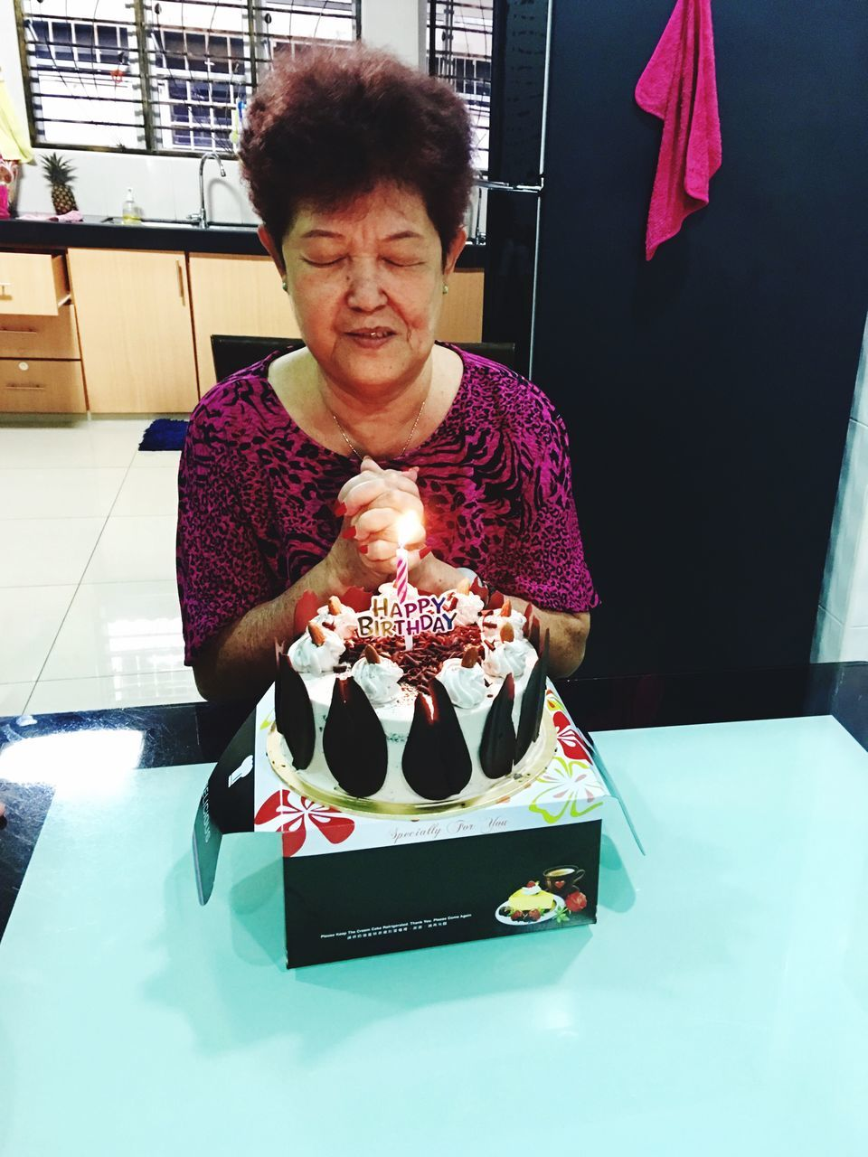birthday cake, birthday candles, indoors, food and drink, food, casual clothing, birthday, front view, one person, real people, table, sitting, sweet food, celebration, unhealthy eating, young adult, freshness, day, people