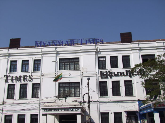 """Myanmar Times Building, """"Heartbeat of the Nation""""! Architecture Blue Sky Building Exterior Building Facade Built Structure Clear Sky Composition Famous Institution Famous Place Fun Heartbeat Institution Institutional Buildings Low Angle View Myanmar Nation Newspaper No People Outdoor Photography Sun Travel Destination Unusual White Colour Yangon"""