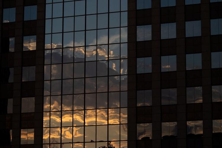 Building reflection Reflection Architecture Building Building Exterior Built Structure City Cloud - Sky Full Frame Glass Glass - Material Modern Nature No People Office Office Building Exterior Outdoors Pattern Reflection Sky Skyscraper Sunlight Sunset Window