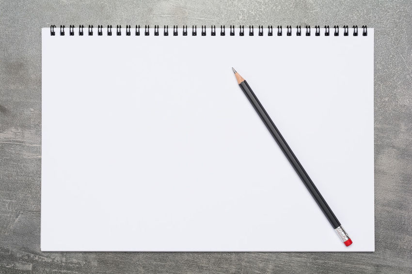 Blank page of a sketchbook with a black pencil on a grunge gray surface Sketch Write Writing Background Blank Cement Copy Space Creativity Draw Education Empty Gray Grey Grunge Ideas Journal Message Note Note Pad Old Paper Pencil Ring Binder Sketchbook White Color