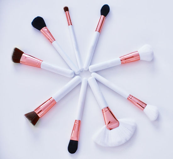 Make-up Still Life White Background Indoors  Studio Shot Beauty Product Variation Arrangement Large Group Of Objects High Angle View Choice Creativity Make-up Brush Lipstick Directly Above Close-up Art And Craft Nail Copper  MakeUp Brushes