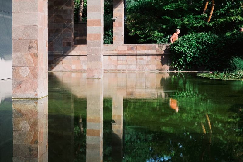Light And Shadow Streetphotography Reflection Architecture Plant Built Structure Tree Water Day Building Exterior Nature Real People Outdoors Architectural Column Green Color Waterfront Reflecting Pool Sunlight Capture Tomorrow