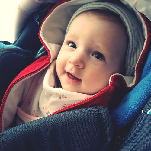 Close-Up Of Cute Girl In Baby Carriage