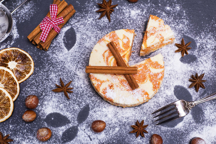 High angle view of cake with cinnamons with star anise