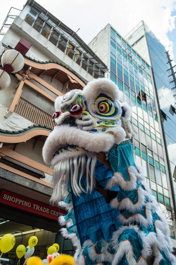 Chinese New Year Chinese Culture Lion Dance Lion Sampa Streetphotography Architecture Building Exterior Statue Built Structure Day Sculpture No People Chinese Dragon Outdoors Sky