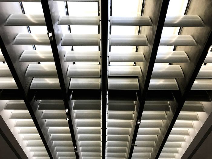 Indoors  In A Row No People Technology Architecture Pattern Repetition Order Metal Side By Side Large Group Of Objects Arrangement Full Frame Backgrounds Equipment Shelf Convenience Built Structure Close-up Business
