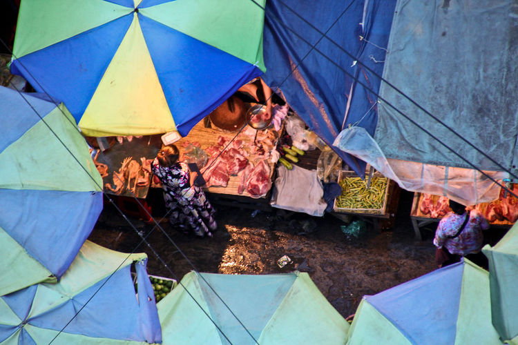 Cambodia Market Adult Blue Day Group Of People High Angle View Leisure Activity Lifestyles Men Multi Colored Nature Outdoors People Protection Real People Security Standing Tent Umbrella Women