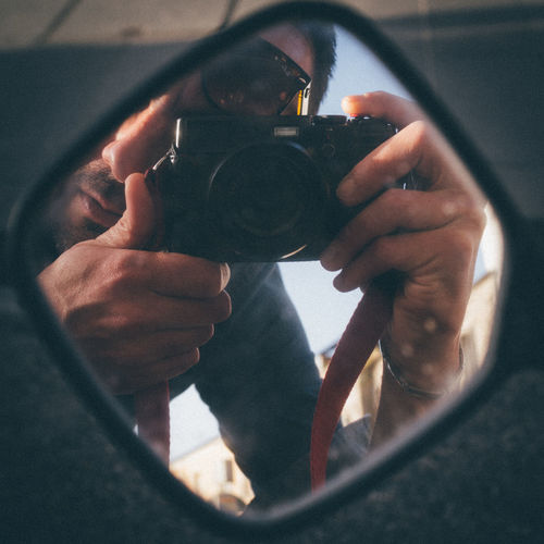 Man photographing through camera