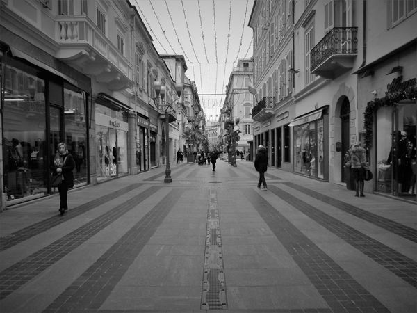 Black And White San Remo Architecture Built Structure Building Exterior Large Group Of People Day City Outdoors People