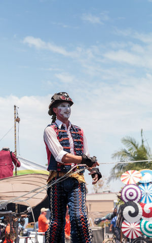 Costa Mesa, CA, USA - July 14, 2017: Performer Benjamin Gadbois with the Dragon Knights steampunk stilt walkers at the Orange County Fair in Costa Mesa, CA on July 16, 2016. Editorial use only. Benjamin Gadbois Costa Mesa Day Dragon Knights Fun Leisure Activity Lifestyles OC Fair One Person Orange County Fair Outdoors People Performance Real People Sky Standing Steampunk Stilt Stilt Walkers Summer Young Adult