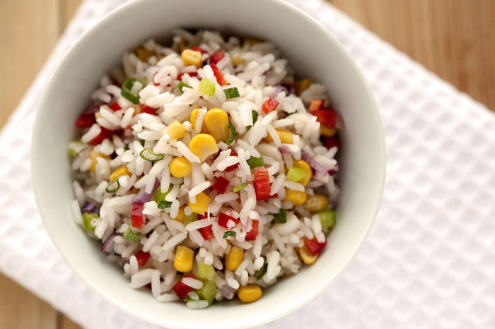 Fresh Rice salad with green and red peppers, corn grains, scallions. Diet Natural Light Rice Rice Salad Bowl Close-up Corn Grain Directly Above Food Food And Drink Green Peppers Healthy Healthy Eating Low Carb No People Ready-to-eat Red Peppers Salad Scallion Studio Photography Summer Salad Vegetable White Napkin Wooden Background