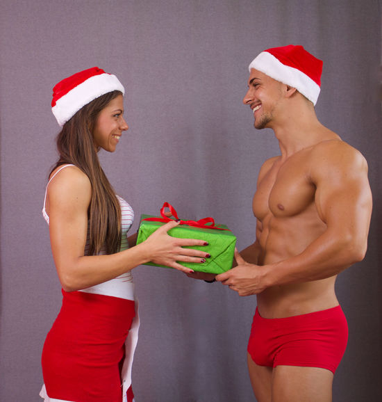 Couple - Christmas Dwarfs Christmas Couple Happy Happy People Man Presents Xmas Christmastime Couple - Relationship Dwarfs Fitness Fitness Dwarfs Fitnessmodel Fitnessmotivation Gifts Happy Time People People Photography Two People Women Young Adult Young Women