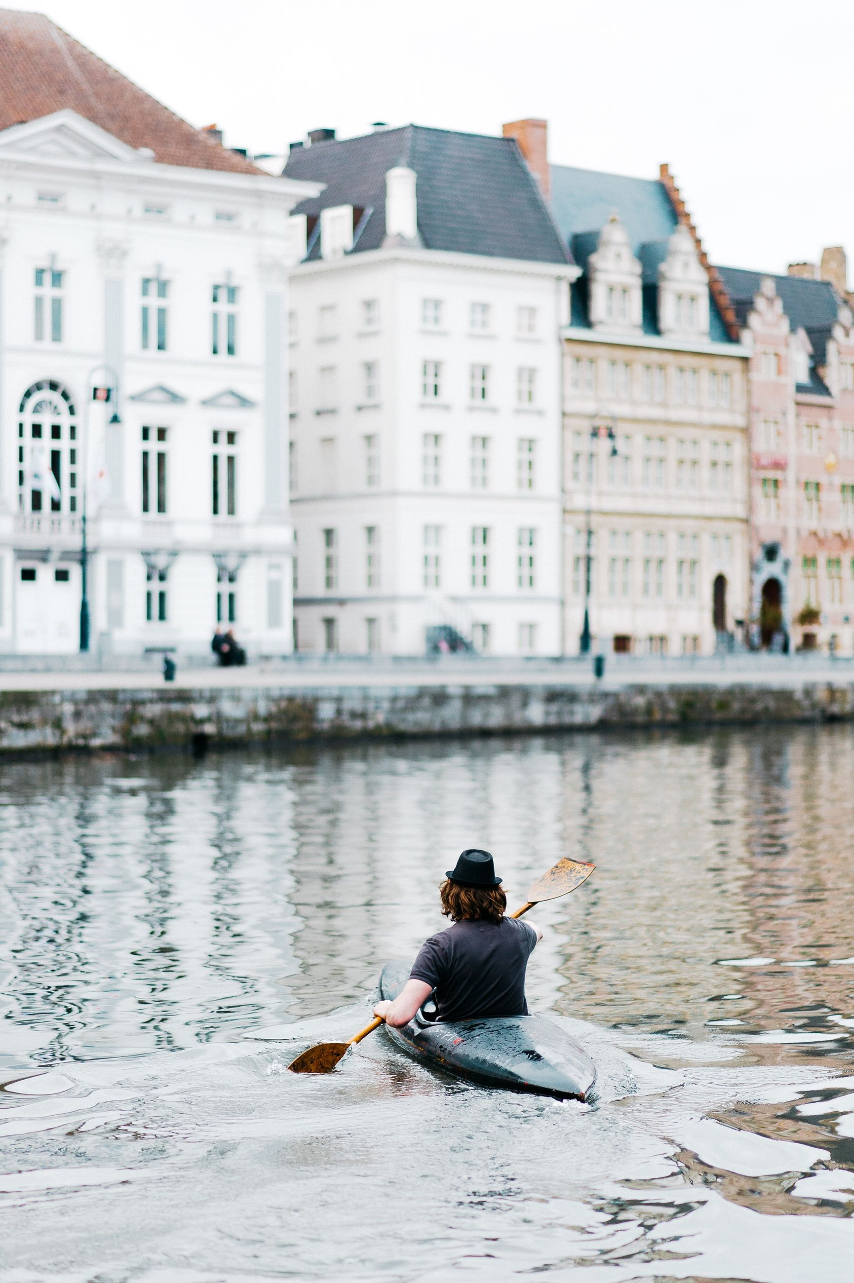 architecture, building exterior, water, sitting, travel destinations, built structure, one person, day, city, bird, outdoors, gondola - traditional boat, rowing, gondolier, people, animal themes, one man only, adult, adults only