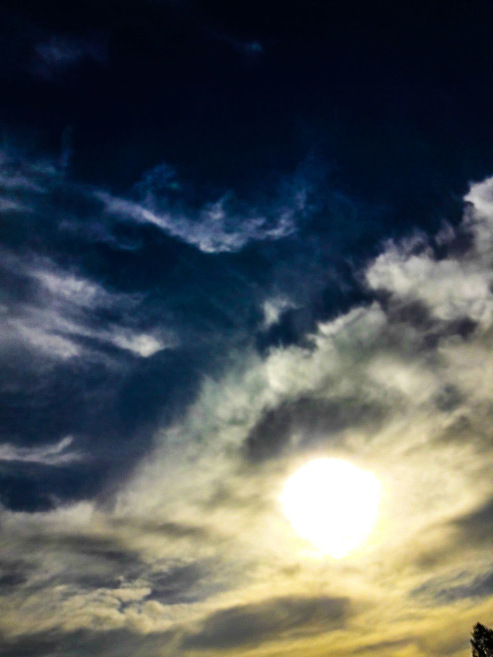 sky, cloud - sky, beauty in nature, low angle view, cloudscape, scenics, nature, sky only, tranquil scene, sun, no people, tranquility, outdoors, backgrounds, sunset, sunlight, day