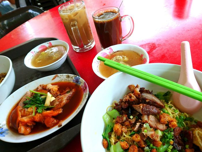 A simple meal of wanton mee and pork trotter in Singapore. Singapore Breakfast Coffeeshop Meal Of The Day