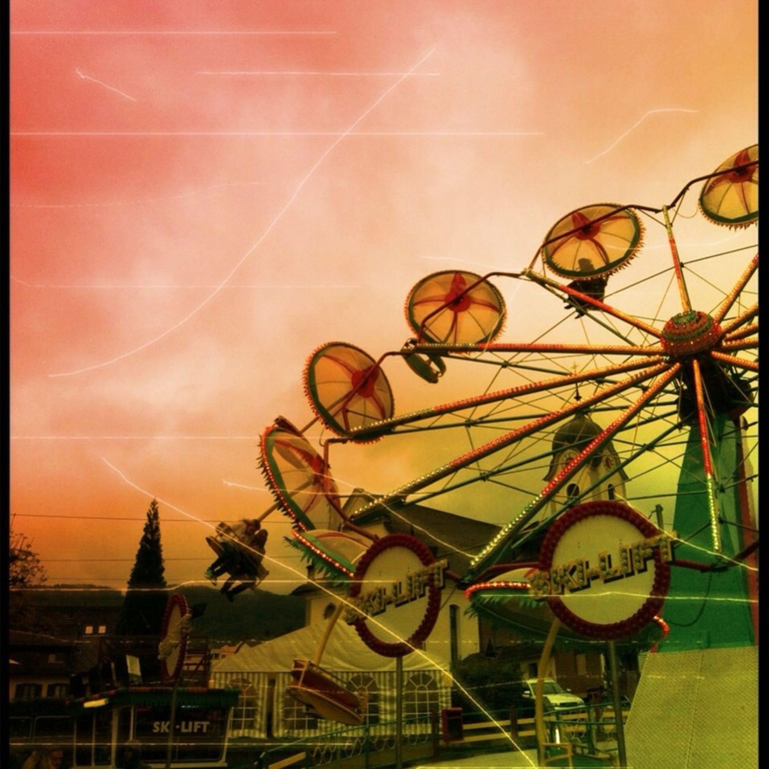 sky, amusement park, sunset, sea, ferris wheel, amusement park ride, transportation, outdoors, horizon over water, water, arts culture and entertainment, cloud - sky, mode of transport, built structure, nautical vessel, creativity, no people, yellow, nature, incidental people
