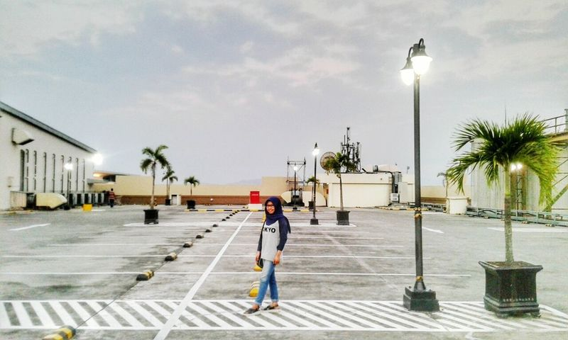 Walk alone Only Women One Person Street Light Walking Palm Tree People Sky City Outdoors Nature Photography Yogyakarta Fine Art Photography EyeEm Gallery Freshness Shining Bright Lighting Equipment Silent Landscape Architecture Nature Landscape Day Building Exterior Cold Temperature Standing