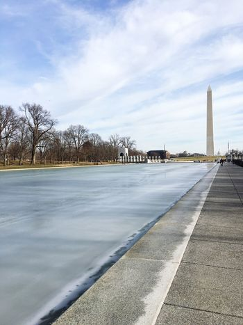 WashingtonDC Monument Sky Cloud - Sky Built Structure Architecture Day No People Outdoors The Way Forward Travel Destinations Nature Tree Water Building Exterior