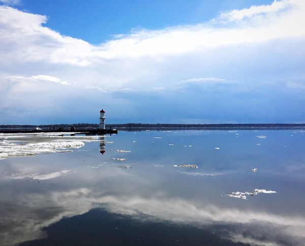 Winterscapes Reflection Cloud - Sky Sea Wintertime Ice Frozen Cold Temperature Light House Lachine Fleuve Saint-Laurent Montréal Tranquil Scene Day Beauty In Nature Water Sky Outdoors Tranquility Nature Scenics